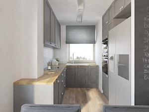 """Dom jednordzinne - Średnia zamknięta wąska biała kuchnia w kształcie litery u z oknem - zdjęcie od Pracownia Aranżacji Wnętrz """"O-kreślarnia"""""""