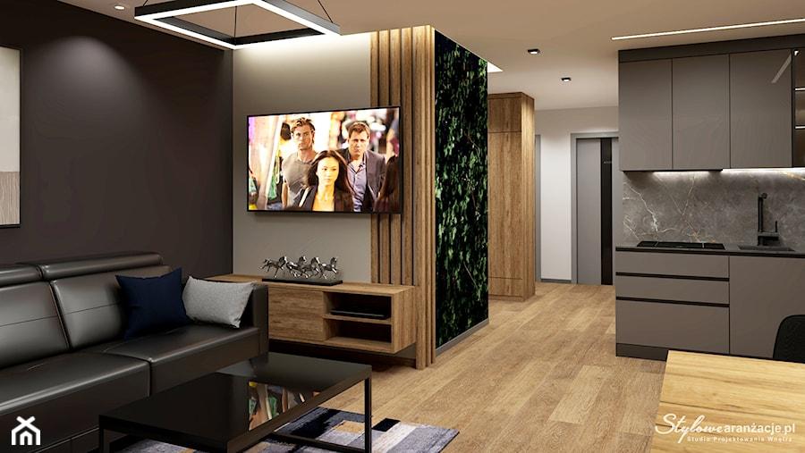 Salon z czarną sofą - zdjęcie od STYLOWE ARANŻACJE Studio Projektowania Wnętrz