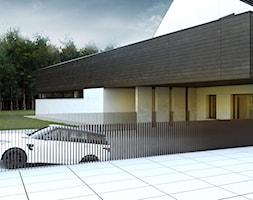 Gara%C5%BC+w+bryle+budynku+-+zdj%C4%99cie+od+BIAMS+Budownictwo+i+Architektura+Marcin+Sieradzki+-+projektant%2C+architekt
