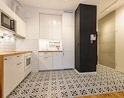 Apartament w Wilanowie - Średnia otwarta biała kuchnia w kształcie litery l, styl skandynawski - zdjęcie od Fotownętrza - Homebook