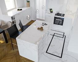 Wnętrza - Średnia otwarta biała kuchnia w kształcie litery u z wyspą z oknem - zdjęcie od Marquardt Design