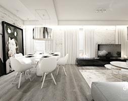 deep focus - Duża otwarta biała jadalnia w salonie, styl minimalistyczny - zdjęcie od Otwarte Studio Sztuka