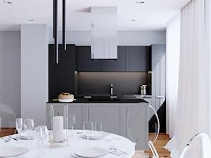 LOG - Średnia otwarta szara jadalnia w kuchni, styl minimalistyczny - zdjęcie od Cutout Architects