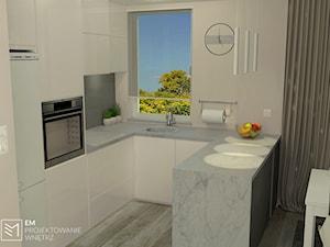 Jasna kuchnia z jadalnią - zdjęcie od EM Projektowanie Wnętrz