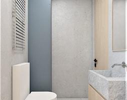 Mieszkanie lastryko Poznań - Mała szara łazienka w bloku w domu jednorodzinnym bez okna, styl minimalistyczny - zdjęcie od zonaarchitekci - Homebook