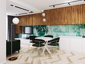 Ultra nowoczesny salon z zielonym akcentem