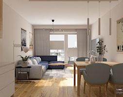 Z niebieskim akcentem - Średni beżowy salon z jadalnią z tarasem / balkonem, styl nowoczesny - zdjęcie od MOOKA Studio - Homebook