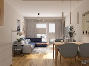 Z niebieskim akcentem - Średni beżowy salon z jadalnią z tarasem / balkonem, styl nowoczesny - zdjęcie od MOOKA Studio
