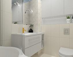 Z niebieskim akcentem - Mała niebieska szara łazienka w bloku w domu jednorodzinnym bez okna, styl nowoczesny - zdjęcie od MOOKA Studio