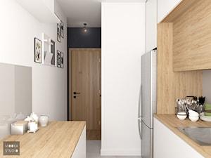 Mieszkanie w Warszawie - Mała zamknięta wąska biała szara kuchnia dwurzędowa, styl nowoczesny - zdjęcie od MOOKA Studio