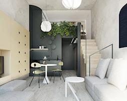 Apartament MiniMaxy. - Mały szary beżowy czarny salon z kuchnią z jadalnią z tarasem / balkonem - zdjęcie od TIKA DESIGN