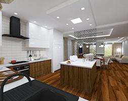 Projekt wnętrz domu prywatnego pod Mińskiem Mazowieckim opcja 2 - Duża otwarta biała kuchnia w kształcie litery l w aneksie z wyspą, styl nowoczesny - zdjęcie od PROJEKTOWNIA Małgorzata Woldańska