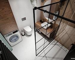 Mieszkanie w stylu industrialnym - Średnia biała brązowa łazienka w bloku w domu jednorodzinnym bez okna, styl industrialny - zdjęcie od Outline of Design