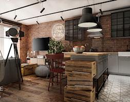 Mieszkanie w stylu industrialnym - Mały szary salon z kuchnią z jadalnią, styl industrialny - zdjęcie od Outline of Design