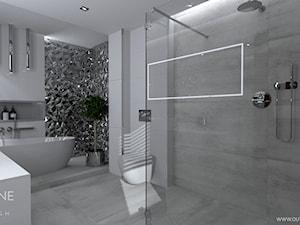 Łazienka w stylu glamour z geometryczną ścianą