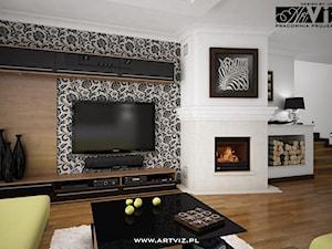 Dom. Salon z otwartą czarną kuchnią
