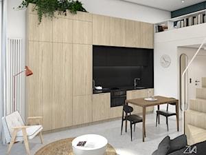Mikromieszkanie z antresolą - Biały salon z kuchnią z jadalnią z antresolą, styl minimalistyczny - zdjęcie od ZKA architekci