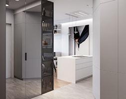 Minimalizm w praskim Koneserze - Średni biały szary hol / przedpokój, styl minimalistyczny - zdjęcie od M!kaDesign