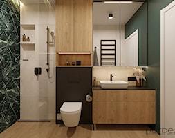 Zielone i jasnobeżowe płytki, szafki laminat drewnopodobny, czarny blat, czarna armatura w łazience - zdjęcie od Monika Hardej Architekt - Homebook