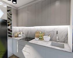 Kuchnia z marmurowym blatem - Średnia zamknięta biała kuchnia w kształcie litery l, styl nowoczesny - zdjęcie od Warsztat Zewnetrza Olga Pawlowska - Homebook