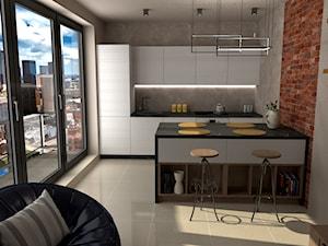 Mieszkanie loftowe - kawalerka - Średnia otwarta beżowa kuchnia dwurzędowa w aneksie, styl industrialny - zdjęcie od GProjekt studio