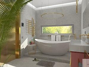 łazienka z złotymi akcentami