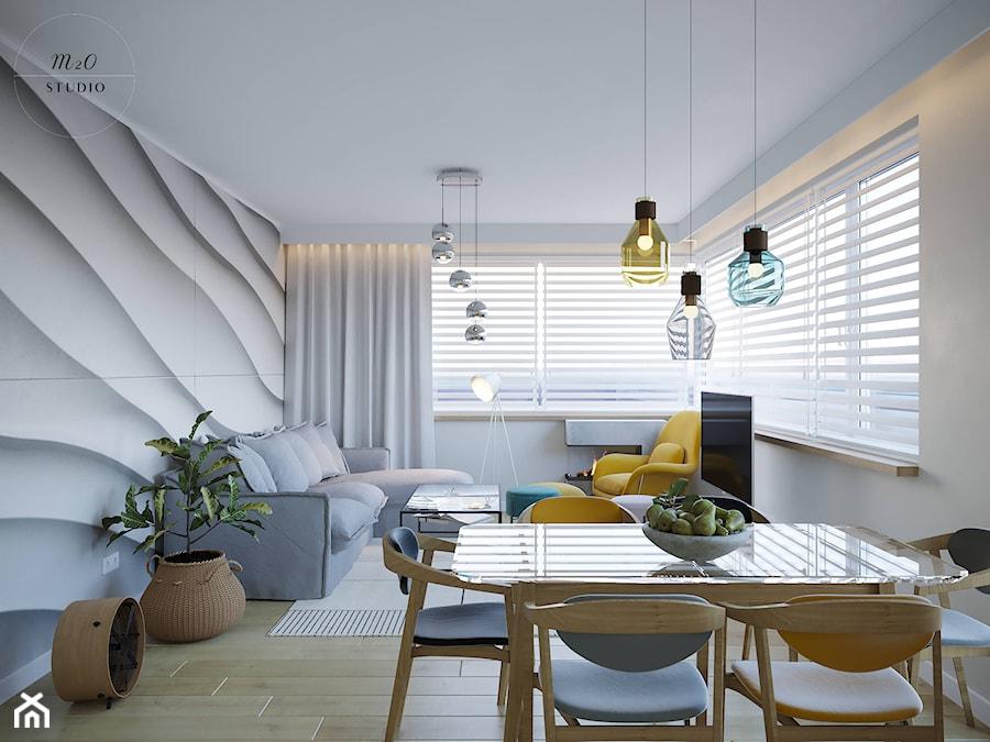 Strefa dzienno - jadalniana w słonecznym mieszkaniu - zdjęcie od m2o studio