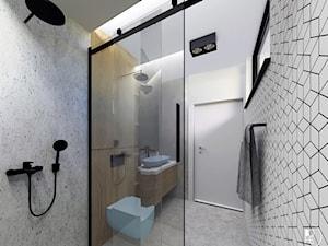 Projekt wnętrza łazienki w Warszawie z niebieskim akcentem