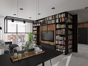 Nowoczesne mieszkanie w czerni i drewnie