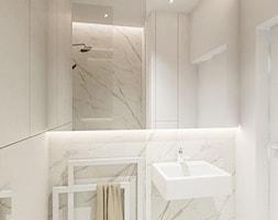 Apartament przy parku w Warszawie - Mała beżowa łazienka w bloku w domu jednorodzinnym bez okna, s ... - zdjęcie od Twój Kwadrat - Homebook