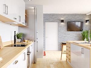 Biała kuchnia skandynawska z wyspą i jasnobrązowymi blatami