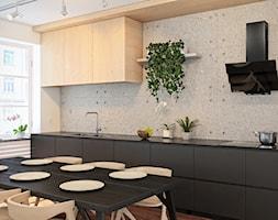 Beton+architektoniczny+w+nowoczesnej+kuchni+z+okapem+ze+szk%C5%82a+hartowanego+-+zdj%C4%99cie+od+Okapy+kuchenne