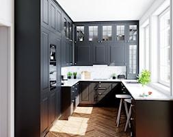 Elegancka kuchnia z czarną zabudową - zdjęcie od OkapyKuchenne.pl - Homebook