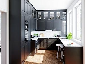Elegancka kuchnia z zabudową w czarnym macie i białymi dodatkami