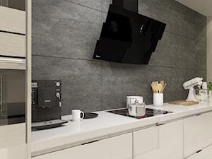 Otwarta kuchnia z wyspą otulona nowoczesną elegancją
