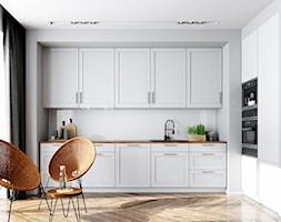 Minimalistyczna kuchnia z białymi meblami i drewnianymi dodatkami - zdjęcie od OkapyKuchenne.pl - Homebook