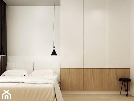 Aranżacje wnętrz - Sypialnia: STRZESZEWSKIEGO - Średnia biała sypialnia małżeńska, styl minimalistyczny - KAEL Architekci. Przeglądaj, dodawaj i zapisuj najlepsze zdjęcia, pomysły i inspiracje designerskie. W bazie mamy już prawie milion fotografii!