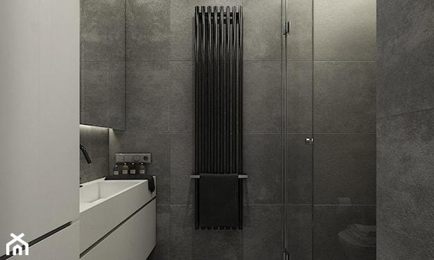 kabina prysznicowa walk-in, szara łazienka, czarny grzejnik, betonowe płytki łazienkowe