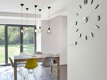 Aranżacje wnętrz - Jadalnia: Elmo - Duża otwarta biała jadalnia jako osobne pomieszczenie, styl nowoczesny - Niuans projektowanie wnętrz. Przeglądaj, dodawaj i zapisuj najlepsze zdjęcia, pomysły i inspiracje designerskie. W bazie mamy już prawie milion fotografii!