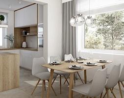 Ciepła nowoczesność - Średnia biała jadalnia w kuchni, styl skandynawski - zdjęcie od KOLORUM - Homebook