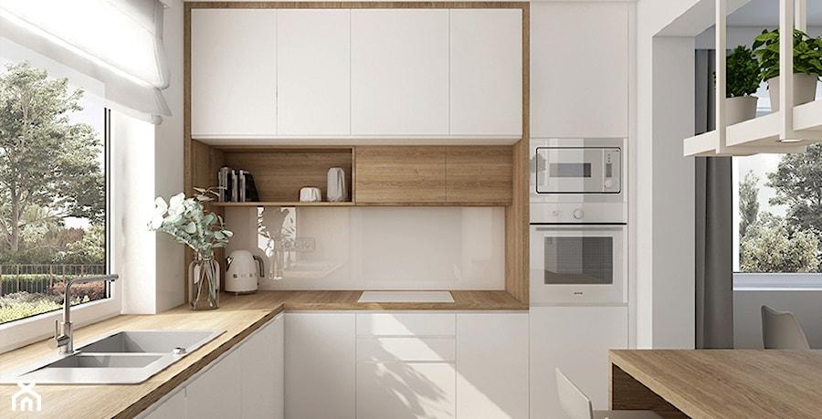Ciepła nowoczesność - Średnia otwarta biała kuchnia w kształcie litery l z wyspą z oknem, styl skandynawski - zdjęcie od KOLORUM