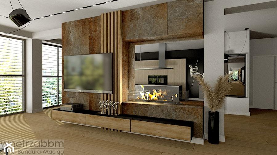 przestronny salon z biokominkiem - zdjęcie od Pracownia Projektowa WnętrzaBBM