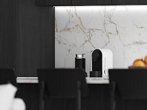 Aneks kuchenny w stylu minimalistycznym w ciemnych kolorach i z jasnym blatem