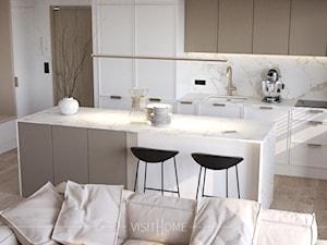 Nowoczesny, jasny salon z aneksem kuchennym w wykonaniu pracowni VISIT HOME