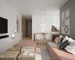 MIESZKANIE Z AKCENTAMI PUDROWEGO RÓŻU - Mały szary biały salon z kuchnią z jadalnią, styl nowoczesny - zdjęcie od TK Architekci