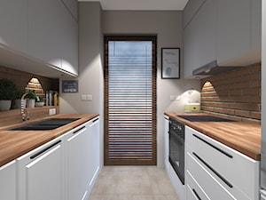 Projekt mieszkania na ul. Indiry Gandhi w Warszawie, 74 mkw. - Średnia wąska biała brązowa kuchnia dwurzędowa, styl nowoczesny - zdjęcie od Patrycja Bedyk Studio Projektowe