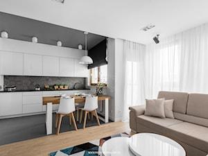 Al. Rzeczpospolitej - Średnia otwarta biała szara kuchnia w kształcie litery l w aneksie, styl nowoczesny - zdjęcie od Patryk Kowalski Design