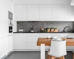 Al. Rzeczpospolitej - Duża otwarta szara kuchnia w kształcie litery l, styl nowoczesny - zdjęcie od Patryk Kowalski Design
