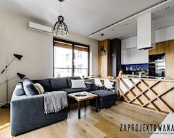 Apartament w stylu skandynawskim - Średni szary salon z kuchnią z jadalnią, styl nowoczesny - zdjęcie od ZAPROJEKTOWANA - Homebook