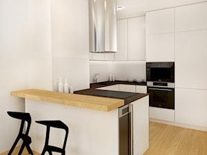 Mieszkanie kawalera. - Średnia otwarta biała kuchnia w kształcie litery u w aneksie - zdjęcie od Studio projektowe Suzume